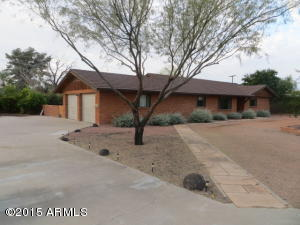 Adobe brick custom on huge lot with circular drive, and 2 car garage