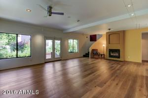 Great Room with all real Wood Floors, Fireplace, Contemporary Lighting Fixtures, Art Spotlights, Guest Bath, Natural Lighting Galore!