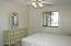 Cozy master bedroom, ceiling fan w/light, west window to golf course.