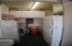 garage showing utility sink, extra refrigerator etc. lots of storage