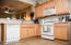 This kitchen layout is efficient and functional.