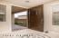 Beautiful mahogany door with 'speak-easy' option; inset medallion in 18-inch tile flooring