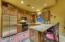 The casita kitchen is shown prior to being newly repainted.