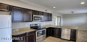 Kitchen has granite, stainless steel appliances & updated cabinets.