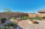 Professionally landscaped yard with adobe brick pavers, along with a gas fireplace!