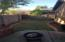 BACK YARD WITH PLANTERS & GRASS...JUST NEEDS TO BE OVERSEEDED