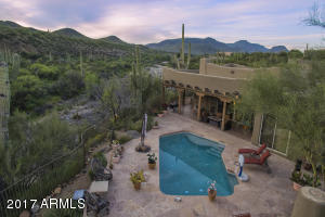 Set over 30 feet above the creek floor! Surrounded by mountains and lush desert landscape!