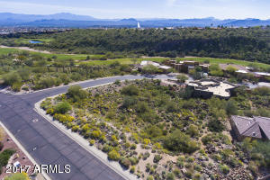 Beautiful aerial of lot with golf course and Fountain in background