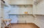 Master walk-in closet with built in shelving
