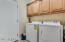 Full size laundry room with built in cabinets