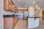 Great open design layout with stunning black granite countertops.