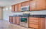 Custom build cabinets with upgraded stainless steel appliances.