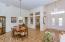 Double door entry, soaring ceilings, separate den/library
