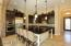 Large island with granite counters.