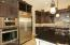 Stainless steel appliances. Oversized refrigerator and convection oven.