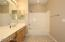 Hall bath for secondary bedrooms has separate water closet