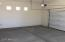 Oversized 25 foot wide garage with natural light, and storage/workspace areas on both sides!