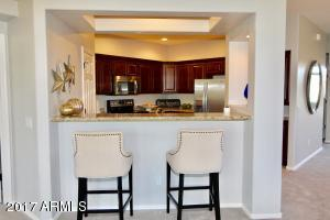 Kitchen counter top. Open design so you can be in kitchen and look out to dining area and great room.