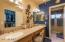 Dual Sinks with Makeup Counter and Walk-in Closet with a Classy Closet Organizer