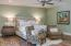 The serene Master Bedroom is classically elegant