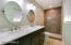 Fully updated master bath featuring double sinks and large shower.