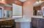 Roman tub, glass block window, separate shower stall & water closet