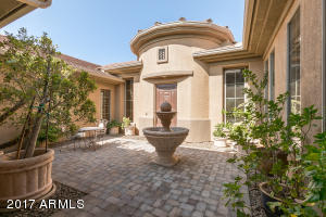 Large, paver stone courtyard greets you with gentle water feature.
