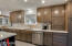 GORGEOUS KRAFTMATE CABINETS ADORN THIS EXPANDED KITCHEN