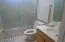Guest Bath features a tub/shower combination