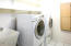 Laundry room with chute upstairs
