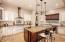 Refinished cabinetry in the Kitchen. Updated tile backsplash.