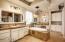 Split vanities in the Master Bathroom. Jetted tub. Step-in shower.