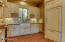 Gorgeous Custom Kitchen complete with pull-out shelves and tray dividers. KitchenAid appliances with cabinet fronts.