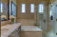 Master Bathroom with custom cabinetry, tile back splash, tile tub and shower surround, and seamless glass shower.