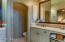 Master bathroom with bronze hardware and fixtures.