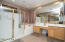 Your master bath has hi-lo double sinks, a make up desk, an extra-large showers, and a private toilet room. There's ample room for morning prep or late night restoration in the garden tub.
