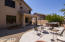 The rear yard has plenty of space for creating outdoor eating, sunbathing spots, or nighttime firepit conversation.