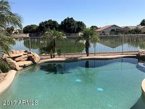 Premium lakefront home site & a refreshing Pebble tec pool with in floor cleaning system.
