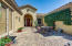 Mexican pavers and a graceful and welcoming arched entrance porch