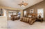 Master Suite with Bay windows sitting area and private exit to pool area.