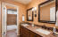 Full Guest Bathroom with Tile surround and Granite slab counters.
