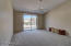 Master is spacious and bright. Sliding door exits to the pool area