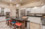 Spacious kitchen note glass fronted cabinets