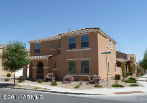 Corner lot in Lyons Gate, Front and side yards maintained by HOA.