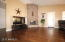 Family Room Includes a Cozy Fireplace and gorgeous Hardwood Floors