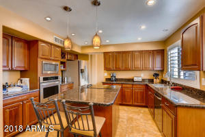 Spacious Kitchen with granite countertops and stainless steel appliances!