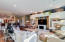 Great room. Entertainment center features recessed lighting.