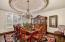 Gorgeous custom ceiling and designer chandelier adore the formal dining.