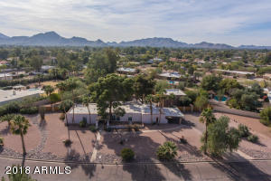 A massive lot in the city on almost 1 acre & tons of mature landscaping for privacy!