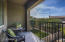 The outdoor balcony off the master bedroom overlooking the backyard.